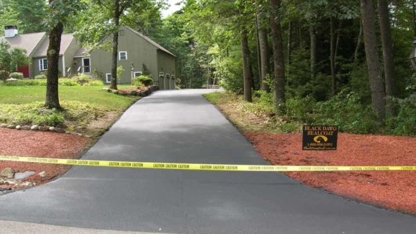 Driveway sealcoating for asphalt driveways protects and extends the life of the driveway