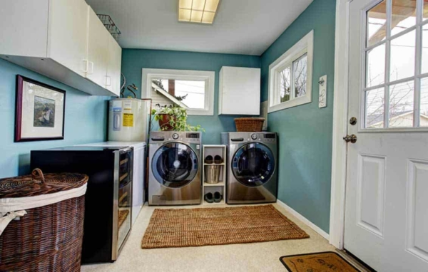 most laundry rooms have cabinets above the washer & dryer
