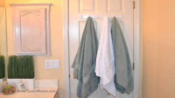 a small bathroom remodel can use hooks for much needed storage