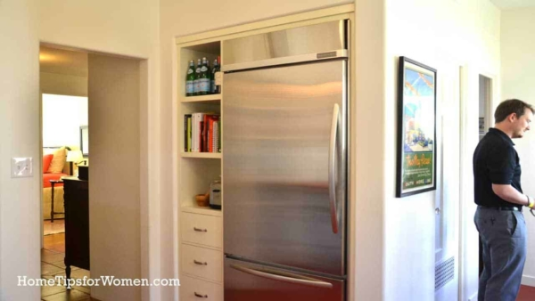if you can't move or remove a wall, one of my favorite kitchen renovation ideas is to to punch through a wall like what was done for this refrigerator
