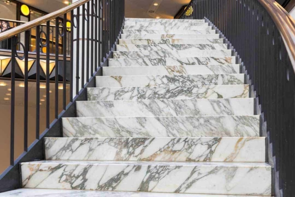 white marble texture was frequently used for stairs in older, now historic buildings