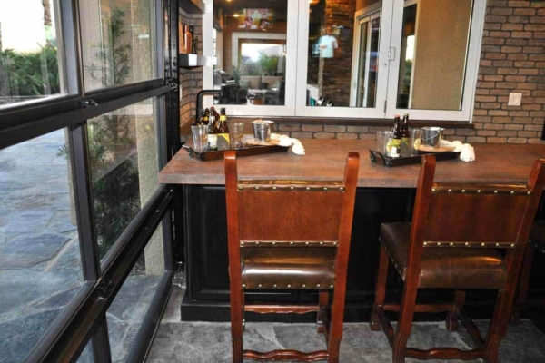 patio living can extend year round with a hangar patio door (looks like a garage door)
