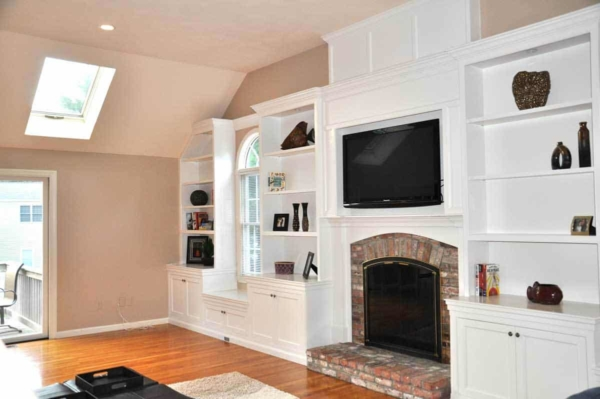 fireplace design trends take into account designing the entire wall, not just the fireplace