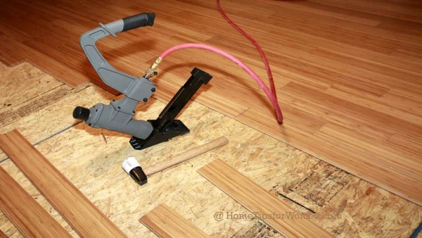 you can install a wood laminate but you should leave installing real wood floors to the professionals for their tools & experience