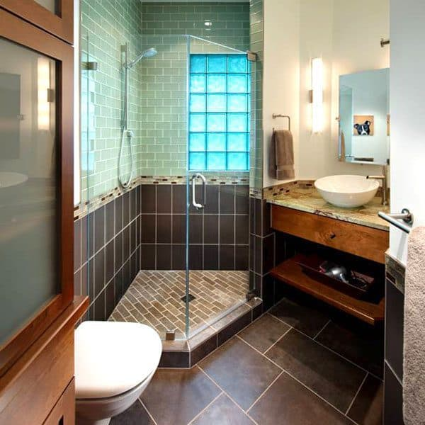 a small bathroom will look larger when flooring is installed on the diagonal