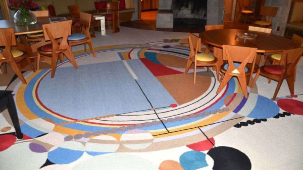 inspirational & brightly colored rug ties this mid-century modern home together end-to-end