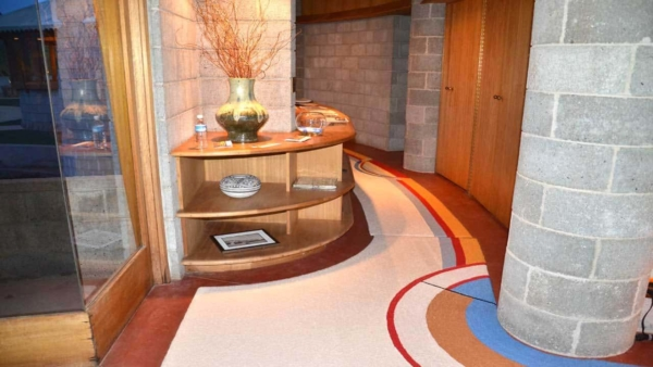 the halls and many of the built-in furniture pieces are curved in this mid-century modern house