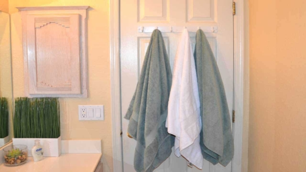 organizing with hooks on the back of bathroom doors is a great solution for many things