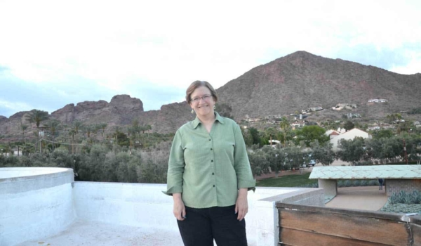 Tina Gleisner, founder of Home Tips for Women, enjoying the view atop the David Wright mid-century modern home
