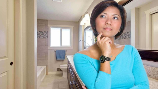 woman thinking through different ideas for her small bathroom