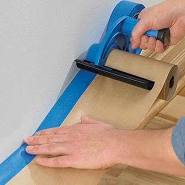 one of my husband's favorite painting tools is this tape-paper dispenser