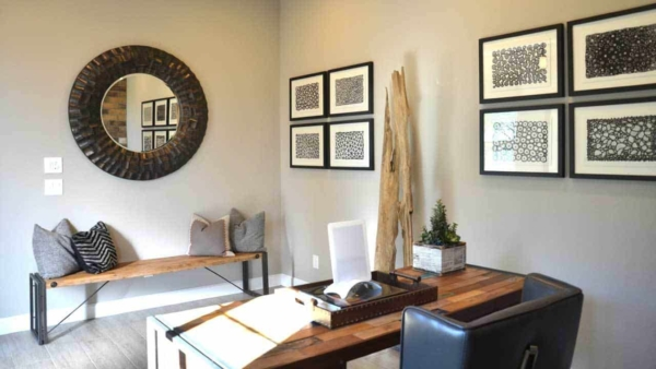 this home office at the front of the house doubles as a entry way, a great idea gleaned from visiting this model house