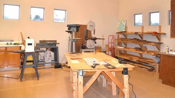 a garage workshop for serious woodworking requires lots of space for large tools & wood