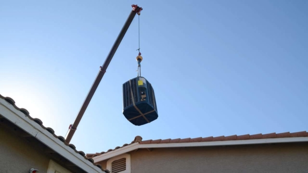 boom-lifting-new-condenser-over-garage-ht4w1280