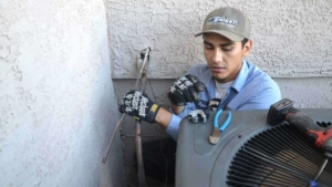an HVAC installation involves cutting & brazing copper pipes