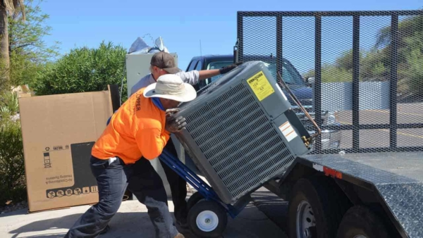 metal-scraping-company-picking-up-old-heat-pump-ht4w1280