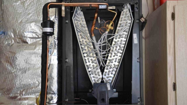 inside the air handler, there's an evaporator coil - key component of a central air conditioner