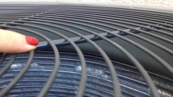 central air condition releases heat into the outdoors through these condenser coils