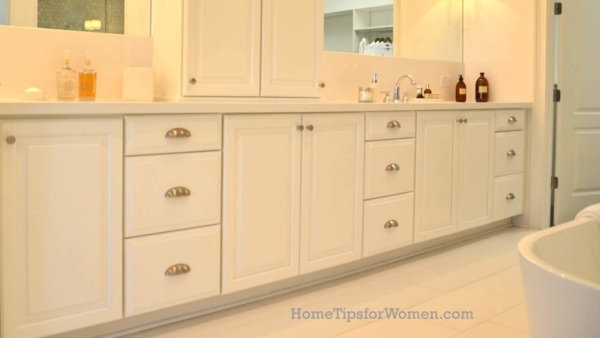 not just for tile tips, you can sometimes use quarter-round molding to cover the gap between a tile floor and cabinets or baseboard modling