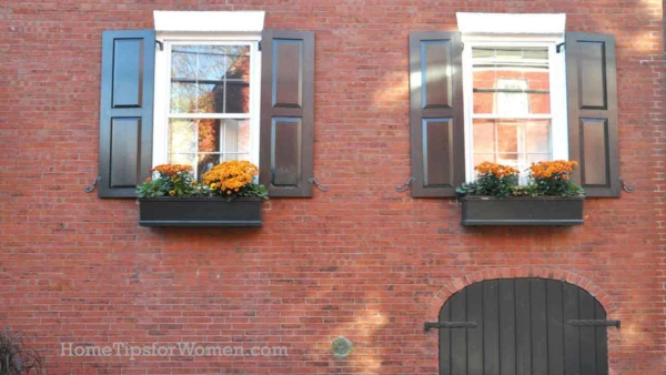 fall home maintenance tips can be combined with decorating your home with fall colors from pumpkins to mums