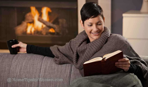 this woman is doing several things to stay warm at home