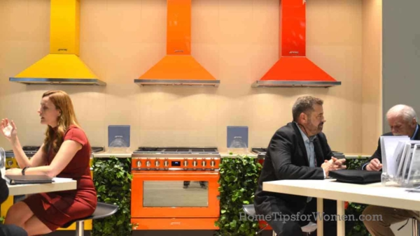 home color trends showing up in the kitchen include stoves & range hoods like these in red, orange, yellow