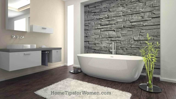 freestanding bathtub set off by marvelous stone wall