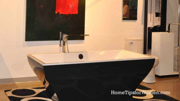 proving that bathtubs come in colors other than white, is this handsome black (exterior) tub