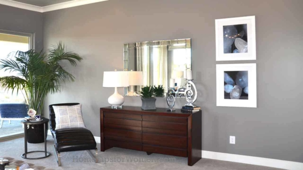 get more interior design tips like hanging pictures at eye level