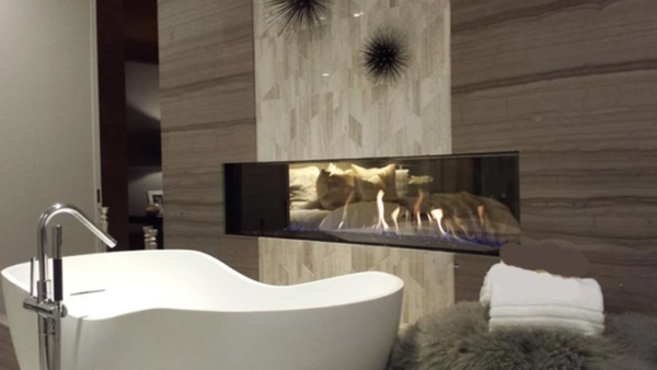 lovely bathroom with fireplace, freestanding tub & more