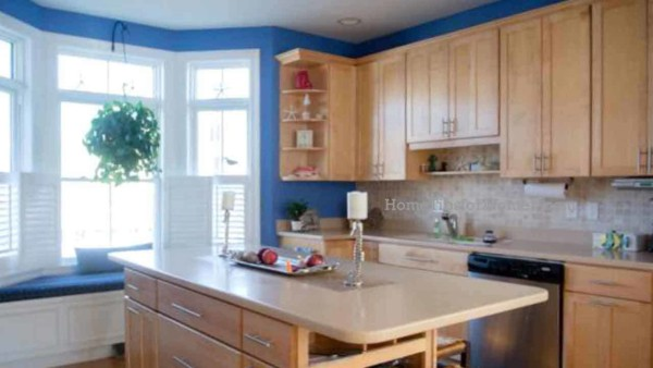 every kitchen needs some color & painting the walls (blue here) gives you the chance to change colors every few years