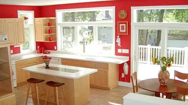 kitchens should be bright & lively like this one with it's red paint & lots of sunshine