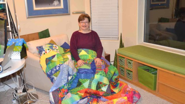Tina Gleisner, founder of Home Tips for Women, sharing one of her colorful quilts